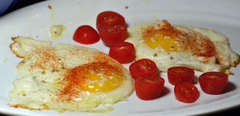 sunny side up eggs topped with queso fresco