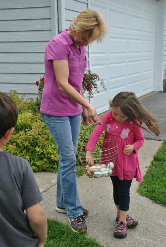 Juliette handling free range farm fresh eggs.