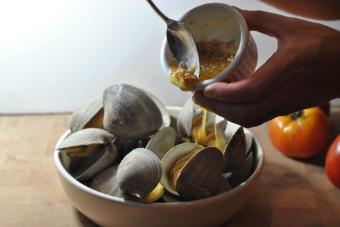 A Sweet shallot Sauce Tops grilled clams