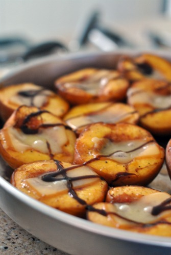 Roasted peaches topped with smoked cheddar
