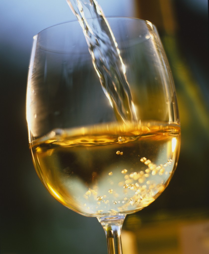 White Wine Poured in a glass