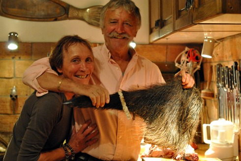 butchering a wild boar leg