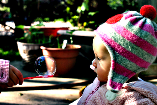 Baby staring at bubble