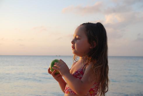 Juju Eating Apple on the Beach