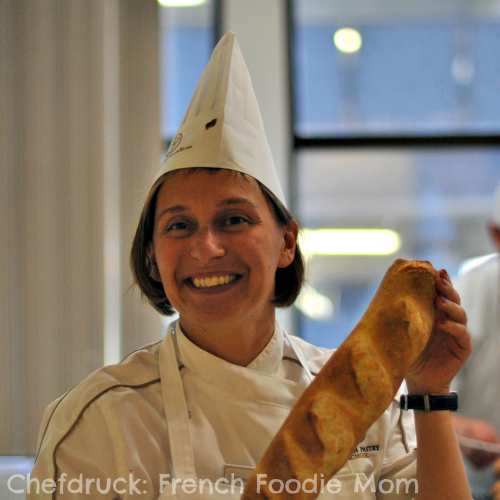 Student with baguette at French Pastry School