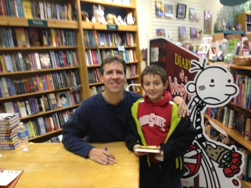 Jeff Kinney with child at book signing
