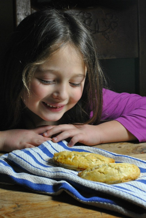 Child with hand pies
