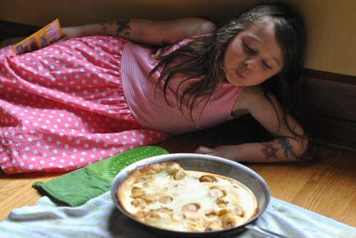 Drama in the kitchen: Juju oohing as Banana Dutch Baby Collapses.