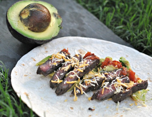 Steak Tacos: perfectly cooked medium rare skirt steak with avocado, salsa, and cheese. HEAVEN!