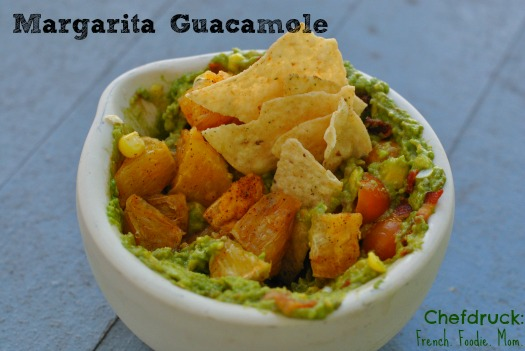 Guacamole studded with tequila marinated orange chunks.