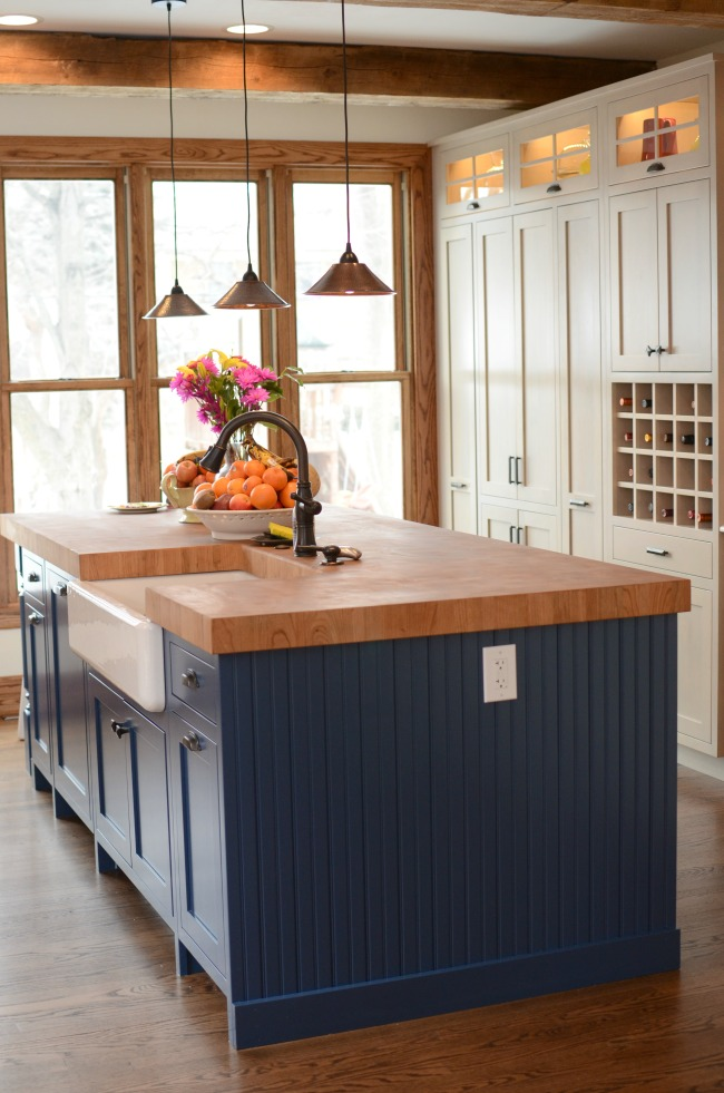 island with frig cabinet in back lower cabinets installed below