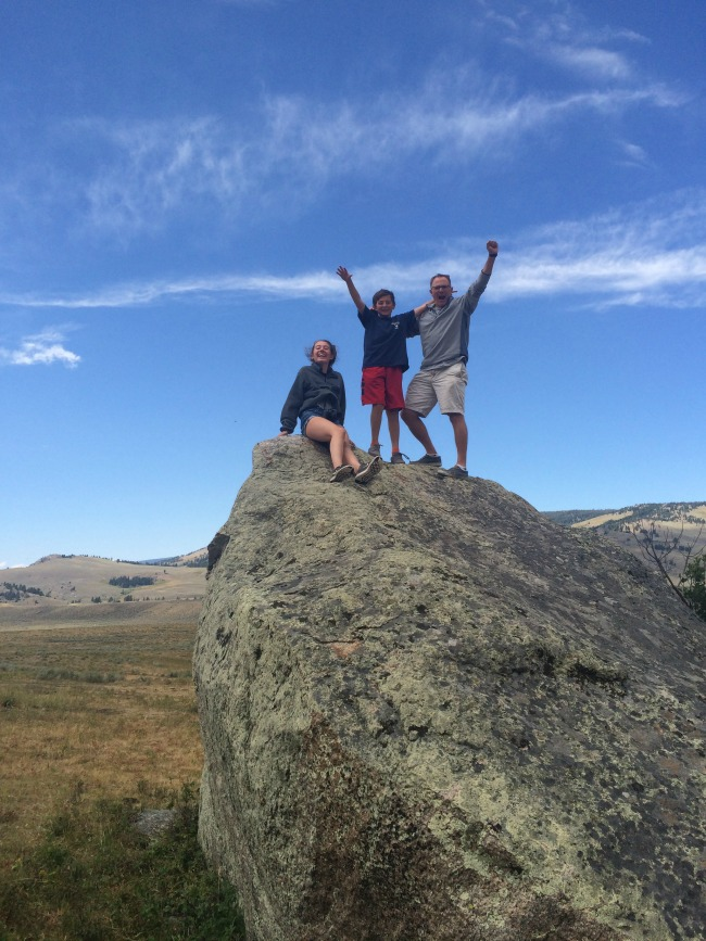 Climbing rocks while hiking in Yellowstone